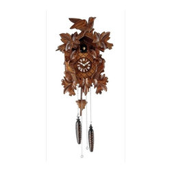 Hermle Clocks - Villengen Hand Carved Black Forest Cuckoo Clock - Styled after the traditional German Black Forest tradition, this cuckoo clock is a graphic, stylish addition to any room. Hand carved wood frame shows leaves and birds. Each hour the cuckoo makes an appearance. Precise quartz movement adds superior engineering behind the scenes. Deeply detailed leaves and birds in a solid wooden case. Wooden dial and pendulum. The cuckoo presents itself every hour to count the hour. The Quartz movement chimes the cuckoo call with a waterfall background . Volume control. Auto night off. 11.75 in. W x 6.25 in. D x 20.5 in. H