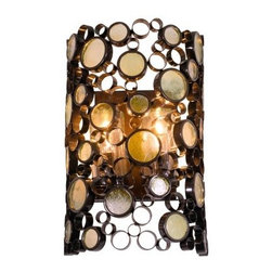 Varaluz Fascination Outdoor Wall Bracket - 12W in. Glossy Bronze with Champagne - With the Varaluz Fascination Outdoor Wall Bracket - 12W in. Glossy Bronze with Champagne Glass you'll feel like you're on Fascination Street. Fascination has been beefed up for sustained outdoor use as its signature recycled steel rings now boast a glossy bronze super outdoor-friendly finish. Its shimmery champagne recycled glass discs provide hours of warm light play long after the sun goes down. About Varaluz:Committed to preserving the earth Varaluz creates products from reclaimed and recycled materials. Most of their lighting fixtures are made from steel containing 70% or greater recycled content and 100% recycled glass. This practice helps cut down on manufacturing waste giving you peace of mind when installing their fixtures in your home.