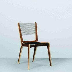 Jacques Guillon Cord Chair - The standout frame of this chair definitely is worthy of stealing the spotlight in any modern dining room.