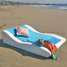 Beach Style Outdoor Chaise Lounges by InteriorDesignerDecor.com
