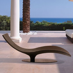 Caribe Outdoor Wicker Chaise - The Caribe outdoor wicker chaise offers a sinuous contemporary design that looks good even when it is not being used.