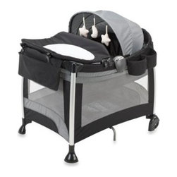 Evenflo - Evenflo BabySuite Premier Playard in Racer Grey - Evenflo BabySuite Premier Playard offers style and convenience. Made using lightweight aluminum tubing with an innovative Rotate-to-Store changer and full-size bassinet.