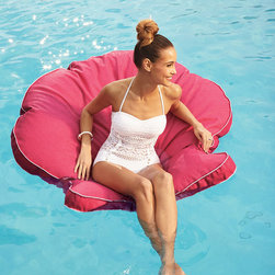Frontgate - Sanibel Shell Pool Float - Puncture-proof vinyl-coated polyester blend fabric is easy to clean and will retain its shape and color for years. 100% EPS foam contours to support your body. Each color features white piping detail. Some might say our Sanibel Shell Float is more tempting than an easy chair at the end of a long day. Luxuriously oversized – with no inflation required, it features soft polyfoam that contours to your body, providing relaxing support in the water or on dry land.  .  .  . Made in USA.