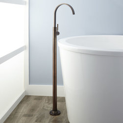 Benkei Freestanding Tub Faucet - The modern Benkei Freestanding Tub Faucet is designed to mount to the floor and attractively arches over the tub with a graceful slim-line spout. A single-lever handle lets you control water flow simply and easily. This striking fixture is crafted of durable solid brass for lasting functionality.