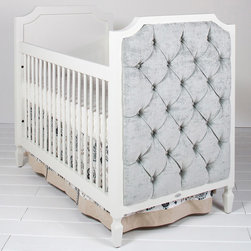 "Newport Cottages - Newport Cottages Beverly Tufted Panel Crib - Newport Cottages creates relaxing and happy nurseries with traditional, bench made furniture. The classic Beverly crib adds a one-of-a-kind design to a little one's room with its clean, sophisticated lines, beveled molding and tufted, upholstered panels. This versatile baby bed features dual level fixed gates and the option of an under-crib storage drawer and toddler guardrail kit. Shown in white, the furnishing is available in several finishes and accent colors. Variance in color or texture is possible due to inherent qualities of handcrafted, hardwood furniture. Available with a choice of fabric. Made in the USA and completed with non-toxic, low VOC finishes.  31""W x 56""D x 45""H. Some assembly required. Mattresses not included. Mattress heights: 22"", 18"" and 14"". COM fabric: 3 yards required*To further customize with additional finish and hardware options, please email shop@laylagrayce.com or call (877) 907-1322 for further details."