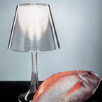 Miss K Table Lamp By Flos Lighting - The Miss K Table Lamp from Flos uses an interesting new material, when lit the diffuser becomes transparent and allows diffused light to shine through.