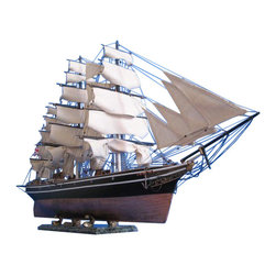 """Handcrafted Nautical Decor - Cutty Sark Limited 50"""" -Wooden Tall Model Ship - British Clipper Ship - Sold Fully Assembled Ready for Immediate Display - Not a Model Ship kit. Museum-quality features and finely-crafted details capture the spirit and pride of the Cutty Sark in this Limited Edition scale replica tall ships model. With devoted attention to historical accuracy, every detail on the Cutty Sark authentically matches that most famous of the tea clipper ships. Serving as the centerpiece of a meeting room, office or den, or perhaps setting a proud nautical tone for a corporate boardroom or family living room, these Limited Edition model tall ships are certain to inspire an indomitable winning spirit. 50"""" Long x 11"""" Wide x 28"""" High (1:67 scale)"""