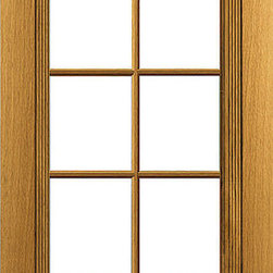 Colonial Doors Glass 10-Lite White Oak Door - This is a traditional 10-lite design door made from solid White Oak hardwood. It has custom trim around the glass with decorative rosettes in the corners.
