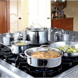 Calphalon - Calphalon Tri-Ply Stainless Steel 13 Piece Cookware Set - 1767951 - Shop for Cookware Sets from Hayneedle.com! To get it all done in just one click you've come to the right place: A professional-grade kitchen is at your finger tips with the Calphalon 1767951 Tri-Ply Stainless Steel 13 Piece Cookware Set. For use with all kitchen utensils. This amazing set includes: 8- 10- and 12-in. omelette pan 1.5- 2.5- and 3-qt. covered sauce pan 3-qt. covered chef's pan 6-qt. covered stock pot Other features Stylish polished stainless steel with Calphalon try-ply layers Provides the most even cooking possible Induction capable Oven- and broiler-safe Stay-cool cast stainless steel handles About Calphalon.Calphalon's mission is to be the culinary authority in kitchenwares enhancing the home chef's food experience during planning prep cooking baking and serving. Based in Toledo Ohio Calphalon is a leading manufacturer of professional quality cookware cutlery bakeware and kitchen accessories for the home chef. Calphalon is a Newell-Rubbermaid company. Calphalon's goal is to give you the home chef all the tools you need to realize your highest potential in the kitchen. From your holiday roasting pan to your everyday fry pan count on Calphalon to be your culinary partner - day in and day out for breakfast lunch and dinner for a lifetime.