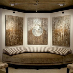 Ice & Alchemy by Jen Belt - This triptych features a rainfall effect of multiple layers of textures and leafing materials finished in silver, gold, and bronze. Center panel of collection hosts a large reliefed medallion finished in silver leafing.