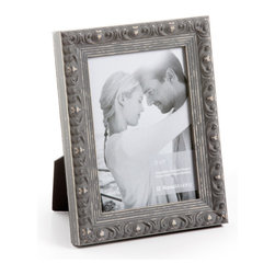 """Origin Crafts - Vintage gray wood picture frame - Vintage Gray Wood Picture Frame Amongst the twenty arrondissements or districts that make up Paris there is a former fortress which stands proud as the focal point of district number one ? the Louvre. A majestic masterpiece where priceless art is encased in classic elegance, founded in the spirit of authentic French tradition. It was here in the Louvre, inspired by its magnificence and contribution to modern culture that Vintage was born. Dimensions (in): Width: 1 1/4, Height: 1 Holds (4""""x6"""", 5""""x7"""", 8""""x10"""") photos. By Roma Moulding - Roma Moulding uses only the highest quality materials. Roma owes it?s renown to exquisite details: meticulous applications of gold and silver leafing, genuine woods, exotic veneers, patinas, superior lacquers and finishes all done by hand. Roma employs time proven techniques to achieve the stunning finishes other manufacturers strive to achieve. Ships within Five Business Days."""