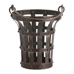 William Large Iron Handled Bucket - The William Large Iron Handled Bucket looks like the artifact of a medieval Anglo-Norman castle, and the weight and quality of its construction bear out the impression.  Its shape � roughly cylindrical, but flaring stylishly outward at the top to meet a broad upper ring � invites a multitude of uses and takes its form from the bends of square bars of natural iron, riveted into a severe and solid-looking open grid.  A tall handle is attached to the top.