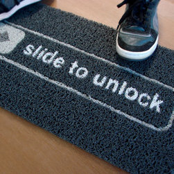 Unlock Doormat - We think this doormat is a fun way to greet your techie friends at the door! While it won't actually unlock the door for you, it's sure to get some laughs from your guests!