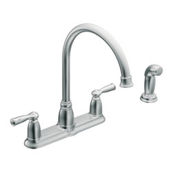"Moen - Moen 87000 Banbury Two Handle High Arc Kitchen Faucet with Sidespray in Chrome - Moen 87000 Banbury Two Handle High Arc Kitchen Faucet with Sidespray in ChromeThe Banbury collection highlights a timeless nostalgia for traditional versatility and sets a tone that is both classical and sensible.Moen 87000 Banbury Two Handle High Arc Kitchen Faucet with Sidespray in Chrome, Features:• High-arc spout provides more clearance• Two lever-style handles• Matching Sidespray• 4-hole application• Spout height: 13-1/8""• Spout reach: 8-7/8""• Hydrolock quick connect system• 1/2"" IPS Connections• ADA Compliant• 2.2 GPM (8.3 l/ min)Specification Sheet - Moen 87000Moen Installation Instructions  Moen Limited Lifetime WarrantyManufacturer: MoenModel Number: Moen 87000Manufacturer Part Number: 87000Collection: BanburyFinish Code: Finish: ChromeUPC: 026508195123This product is also listed under the following Manufacturer Numbers and Finish Codes:Moen-87000        87000        Moen 87000        MO87000Product Category: Kitchen FaucetsProduct Type: Two Handle Kitchen Faucet with Sidespray"