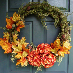 XL Rustic Autumn Wreath from HomeHearthGarden - This wreath captures the colors of autumn. A handmade wreath for fall features artificial fall leaves and hydrangeas detailed with maidenhair fern and berry bush green accents on a grapevine wreath base. An excellent addition for your fall and Thanksgiving entryway decor or as a wreath over the fireplace.