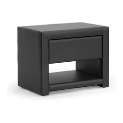 "Wholesale Interiors - Massey Black Upholstered Modern Nightstand - Hide all your bedtime necessities with style. Ideal for use alongside platform beds designed to rest very close to the floor, the petite Massey Designer Nightstand is made in Malaysia with a sturdy plywood and hardwood frame topped with a thin layer of foam padding and black faux leather. Storage features include a single drawer for all your bedtime necessities as well as a single open shelf. The modern bedside table, which comes fully assembled, is also available in white (sold separately). To clean, wipe with a damp cloth. Product dimension: 19.5""W x 13.75""D x 16""H , drawer(1): 13.75""W x 10.75""D x 3.37""H."