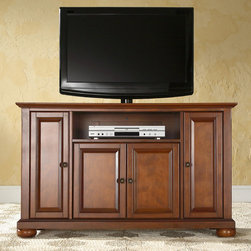 """Crosley - Alexandria 48"""" TV Stand - Enhance your living space with one of Crosley's impeccably-crafted TV stands. This signature cabinet accommodates most 42'' flat panel TVs and is handsomely proportioned featuring character-rich details sure to impress. Raised panel doors strategically conceal stacks of CDs/DVDs, gaming components and various media paraphernalia. Open storage area generously houses media players and the like. Adjustable shelving offers an abundance of versatility to effortlessly organize by design, while cord management systems tame the unsightly mess of tangled wires. Customize our distinct cabinets by selecting one of four collection styles (featuring tapered, traditional, turned or bun feet). This customizable cabinet approach is designed for easy assembly, built to ship and constructed to last. Features: -Raised panel doors.-Five adjustable interior shelves for storing electronic components, gaming consoles, DVDs and other items.-Adjustable levelers in legs.-Recommended TV Type: Flat screen.-TV Size Accommodated: 48"""".-Powder Coated Finish: No.-Gloss Finish: No.-Material: Hardwood and veneers.-Solid Wood Construction: No.-Distressed: No.-Exterior Shelves: Yes -Number of Exterior Shelves: 1.-Adjustable Exterior Shelves: No..-Drawers: No.-Cabinets: Yes -Number of Cabinets: 3.-Number of Doors: 4.-Door Attachment Detail: Pin hinge.-Interchangeable Panels: No.-Magnetic Door Catches: Yes.-Cabinet Handle Design: Knob.-Number of Interior Shelves: 5.-Adjustable Interior Shelves: Yes..-Scratch Resistant : No.-Removable Back Panel: No.-Hardware Finish (Finish: Black): Brushed nickel knobs, steel hardware.-Hardware Finish (Finish: Classic Cherry, Vintage Mahogany): Antique brass knobs, steel hardware.-Casters: No.-Accommodates Fireplace: No.-Fireplace Included: No.-Lighted: No.-Media Player Storage: Yes.-Media Storage: No.-Cable Management: Hole in back for wires.-Remote Control Included: No.-Batteries Required: No.-Weight Capacity: 200 lbs.-Swatch Availab"""