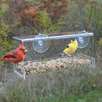 Songbird Essentials - Clear View Deluxe Open Diner Window Feeder - Up close and personal bird watching. Great for introducing children to birding. Easy-to-fill open tray holds 4 cups of seed. Covered roof provides all-weather feeding. Constructed of heavy, clear acrylic. 2 large suction cups attach securely to window.