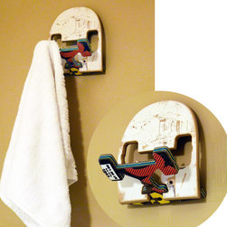 SkateHook - Recycled Skateboard Wall Hook - A cool and very functional wall hook that looks like a skateboard tail and truck! Made from real broken skateboards, the unique scrapes, scars and artwork make every piece one-of-a-kind. Works great as a coat hook or a towel holder. A fun place to hang your gear or bags. The SkateHook can even be used as a charging station for your cell phone or smaller tablet devices.