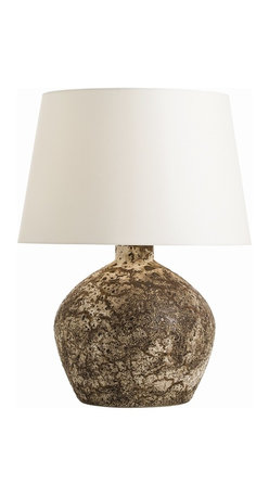 Arteriors - Eddy Lamp - Add a rustic touch to your bedside or living room with this beautifully distressed lamp. The ceramic pot exudes a richness of color and texture with multiple layers of glaze. Top it off with the ivory shade and the results are elegant and refined without being too precious.