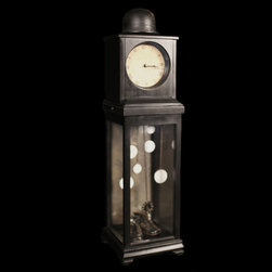 Charlie Chaplin Clock - A functional clock sculpture made from vintage clock mechanisms and various idiosyncratic treasures. On every hour, the tower releases a few calming tones as its' pendulum rocks back and forth. This piece is newly made with vintage parts.