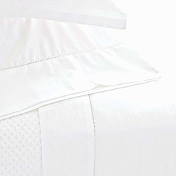 Classic Hemstitch Sheet Set - A delicate row of tone-on-tone stitching becomes noticeable against the pale, sleek solid tone of the Classic Hemstitch Sheet Set, a sophisticated way to bring the practical comfort of cotton into the bedroom.  Create the impression of simple tradition with these solid sheets and their deep hems; combined with a smooth, soothing touch, the look offers an air of relaxed, comfortable polish.