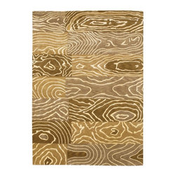 Couristan - Couristan Pokhara Wood Grain Gold/Beige Area Rug - 9931/1100-3.6X5.6 - Shop for Rugs and Runners from Hayneedle.com! Create a unique focal point in your home with the Couristan Pokhara Wood Grain Gold/Beige Rug. The pattern of the rug resembles blocks of carved lumber with white lines creating the actual grain. This hand-knotted rug is made of 100% semi-worsted New Zealand wool using a time-honored Indo-Nepalese weave resulting in the 0.39-inch pile height. The rug is then double-washed to provide a soft hand and rich look. To preserve the beauty and color spot-clean as needed. Available in a variety of shapes and sizes this rug is made in India for Couristan Rugs. One-year limited warranty.Sizes offered in this rug:Following are all sizes for this rug. Please note that some may be currently unavailable due to inventory. Also please note that rug sizes may vary by up to 4 inches in dimensions listed.Dimensions:3.6 x 5.6 ft.5.6 x 8 ft.8 x 11 ft.9.6 x 13 ft.2.6 x 8 ft. RunnerAbout Couristan RugsThe renowned Couristan Rug Company is headquartered in Fort Lee N.J. The company continues to take great pride in its 78-year-old commitment to excellence by weaving four key components - Trust Style Quality and Innovation - into each and every product it imports or manufactures. This commitment has earned the company a long-standing and successful position in the floor covering industry while providing its customers with the highest levels of design value and customer service.