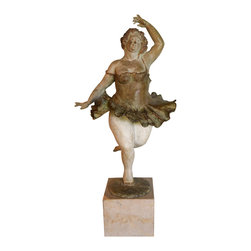 Ballet Dancer - The bronze ballerina in a tutu of warm shades of brown stands on a marble cube and is signed by Elena Boukingolts.