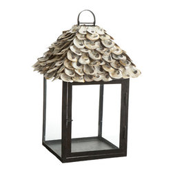 Large Oyster Shell Lantern - This large, handcrafted lantern is big enough to hold three, two-inch diameter pillar candles for added light in really dark places. We love these as part of a centerpiece for a large spread or lining a covered patio.