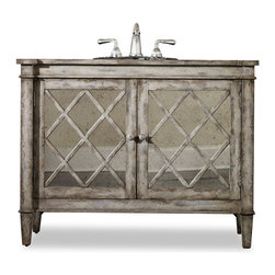 """Cole & Co - Designer Kelley Sink Chest - Two doors open for storage. Rustic handpainted lattice work. Complemented by antique mirror. Made from hardwood solids. 44 in. W x 20 in. D x 34 in. H (121 lbs.)You'll look like an experienced antique hunter with the Kelley Sink Chest in your home. Cole + Co. Carlylse or Coventry Drop-in sinks for use with existing wooden top; Cole + Co. Fairfield undermount should you want to add your own granite, marble or quartz top.  If stone top is preferred, please note on order """"Cut for Granite"""" and our craftsmen will cut a large hole in the top of the vanity prior to shipment so that sink positioning during stone top installation is easier.  Please note all sink recommendations presume a standard 8 in. widespread faucet installation with 1 3/8in. valves and no special placements.  Any and all vanities with custom cuts (including for a specified sink or stone top) are considered a special order, and therefore are non-returnable.  Cole will also cut to your own custom sink presuming it fits.  Just note on the order which sink you will be using.  If we do not have a template for your particular sink, to insure a proper fit, we may require you to send the sink or a template."""