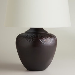 World Market - Bronze Embossed Table Lamp Base - A sophisticated floral pattern adorns the contoured silhouette of our Bronze Embossed Table Lamp Base for an absolutely chic look. Made of bronze-finished steel, this unique, affordable lamp is perfect for illuminating any nightstand, side table or console table.