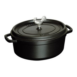 Staub - Staub Coq au Vin Cocotte 5.75 qt. - Black - 1123123 - Shop for Dutch Ovens from Hayneedle.com! The Staub Coq au Vin Cocotte 5.75 qt. - Black will quickly become your pan of choice for stews roasts soups casseroles and other one-pot dishes. Constructed of cast iron this incredibly durable pan features an extra-heavy lid that seals moisture in and dozens of well-placed spikes that continuously baste the pans contents ensuring your dish retains the full flavor of each ingredient. When it's time for clean up simply pop this pan into the dishwasher. The high-quality enamel coating resists scratches and will never discolor.About Staub CookwareFrom professional chefs to home cooks people with a passion for cooking rely on Staub cookware. Combining the utility of cast iron with the latest technology available Francis Staub designed his first enameled pot in 1974 in the Alsace region of France. Known for performance style and durability Staub has become the benchmark for enameled cast-iron cookware. Ideal for braising searing roasting and caramelizing food Staub's signature pots - called cocottes - feature an enameled interior with a matte black finish. Resistant to rust chipping and cracking cocottes are available in round and oval shapes in a variety of sizes and colors. Just right for slow-cooking food Staub cocottes are designed to provide even heat distribution excellent heat retention and continuous self-basting. The inside of each heavy snug-fitting lid features a series of bumps (or self-basting spikes) to allow continuous natural basting by distributing moisture throughout for extra flavor and tenderness. In addition to its signature cookware which is perfect for serving at the table Staub also offers pans for frying sauteing grilling and roasting as well as a variety of teapots accessories and gourmet specialty items.