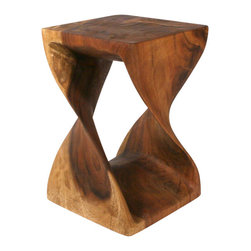 Strata Furniture - Twist Table, 10x18 Black Walnut - This piece will get your heart all twisted up with adoration! Hand carved from eco-friendly Monkey Pod wood with an eco-friendly Livos Black Walnut Oil, this Twist sits 20 inches tall and 12-by-12 inches in width. It is truly one of a kind due to the variations in the wood's colors, grains, and knots. This piece would make a fantastic end table or small display table in a contemporary or transitional home! As with all natural exotic wood products there will be some slight variation in color, texture, and finish color. There will be various separations or cracks on your piece when it arrives - these naturally occurred as the wood was dried and shrank. These variations do not compromise the structural performance or integrity of the wood and are considered inherent to the natural beauty of the design. These variations are not considered flaws and not acceptable reasons for returns.