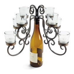 "Frontgate - Eight-votive Wine Bottle Candelabra - Sturdy iron ""cork"" inserts into the neck of the bottle for balance. Rustic, hand-forged design complements most décor. Makes a unique gift for a wine lover or hostess. The votive version arrives with glass votive holders. Candles sold separately. Repurpose your favorite wine bottle into an elegant candelabrum. Hand-forged iron is shaped into a perfectly balanced candelabrum that simply sits atop any bottle of wine. Sturdy iron ""cork' inserts into the neck of the bottle for balance . Rustic, hand-forged design complements most decor .  .  .  ."