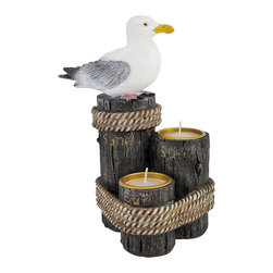 Zeckos - Sea Breeze Seagull on Pilings Double Tea Light Candle Holder - This lovely double tea light candle holder features a nautical theme of a seagull sitting on one of a trio of pilings. The other two pilings have recessed tops to hold tea candles perfectly. The pilings are marked with 'Sun', 'Surf' and 'Sand', respectively. Measuring 7 1/2 inches tall, 6 inches wide, and 4 1/2 inches deep, it has excellent detail, from the grain of the wood on the pilings to the individual feathers on the seagull. It adds a great nautical accent to dressers, end tables and coffee tables, and makes a great gift.