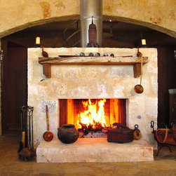 Comfort Castle - The wood mantel was cut from a dead mestquite tree on the property.  The fireplace is gas-fired so it can either light a wood fire or be used as a gas flame fireplace.  The firebox is prefab.