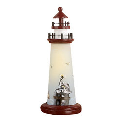 """Pelican Nightlight - The pelican nightlight measures 18""""H. The nightlight is shaped like a lighthouse  features a pelican sitting on pilings. It will add a definite nautical touch to whatever room it is placed in and is a must have for those who appreciate high quality nautical decor. It makes a great gift,impressive decoration and will be admired by all those who love the sea."""