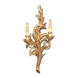"Inviting Home - French style sconce with leaf motif - 18th-century French style sconce in antiqued gold leaf; 12-1/2"" x 25-1/2""H; hand-crafted in Italy; 18th-century French style wall sconce is hand crafted following antique artisan traditions. The most international source of design inspiration nature becomes the focal point for this wall sconce (also known as a wall bracket). This two-light electrified wall sconce is sculpted in leaf motif. The organic and graceful lines of the leaves create a three dimensional quality to the sconce that can be experience from any point in the interior. The distinct shape of uprising serpentine lines of the wall sconce arms are suggestive of natural movement. The sculptural quality of this sconce transcends the viewer from a visual experience to the desire to reach out and touch the graceful forms. The open lighting from the candelabra bulbs reflects upon the sconce emphasizing the various tones in the rich antiqued gold leaf finish. UL approved - dry location; hardwire; 2x 60W max. candelabra bulds; bulbs not included. Handcrafted in Italy."