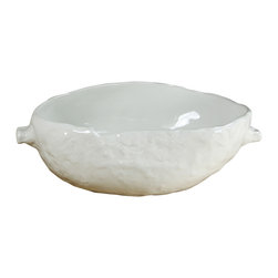 Montes Doggett - Handmade Primitive Serving Bowl - These handmade ceramics lend an organic feeling to any table setting. The textured exterior and handles are a fresh take on a classic serving shape. And while the design is imported from Peru, you don't have to treat these with kid gloves. They are dishwasher, oven and microwave safe!