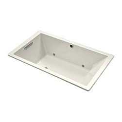 Kohler  Underscore Acrylic Soaking Tub - I love the crisp clean edge of the front of the tub - perfect for running tile up to and around. This is a great tub if you're looking for something modern, deep and streamlined.