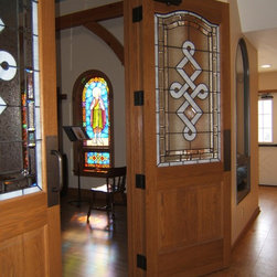 Chapel Doors - Two panel Red Oak French Provincial double doors with custom glass.