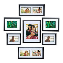 Philip Whitney - 7 Piece Frame Set With Matting - Achieve a simple, clean look in your home using this Frame Set. Featuring plain black wood and white matting, this frame set includes seven frames with options for double mounts, side-by-side photos and horizontal and vertical arrangements. Display the frames individually or layer them for a dynamic, gallery-style effect.