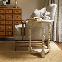 Lexington Home Brands Twilight Bay Bailey Antique Linen Wood End Table - For a table crafted from solid hardwoods, the Lexington Twilight Bay Bailey Antique Linen Wood End Table adds a pleasant lightness that isn't exactly easy to find. The slightly distressed and crackled antique linen finish can be traditional when you need it, or it can be a pleasing counterpoint in a modern setting. Turned legs and a rounded top complement the sturdy and triangular base that also adds additional storage to this unique accent piece.About Lexington Home BrandsFounded in 1903 in High Point, NC, Lexington Home Brands has become a global manufacturer and marketer of unique home furnishings. They are an industry leader in design, style, and quality products. Their product line consists of upholstered and hardwood furniture under recognized brands such as Lexington, Tommy Bahama, Sligh, and Henry Link Trading Co.. Lexington Home Brand's intentions and aspirations are to create exclusive designs and styles that accommodate the traditional, contemporary, casual, and formal decors of their customers' homes.
