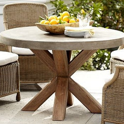 "Abbott Round Concrete Top Dining Table - The rugged, casual look of concrete provides a perfect backdrop for outdoor entertaining. Our table's eco-friendly, solid eucalyptus base creates a handsome contrast. 48"" diameter, 30"" high Crafted of eucalyptus with a concrete top. View our {{link path='pages/popups/fb-outdoor.html' class='popup' width='480' height='300'}}Furniture Brochure{{/link}}."