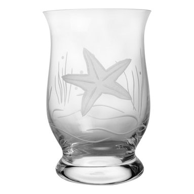 Rolf Glass - Starfish Hurricane - Place a simple white candle inside this curvy hurricane lamp and softly illuminate your patio table in its gentle glow. A engraved starfish floating in sea grass adds beach-house appeal.