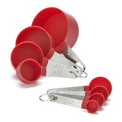 Prime Pacific - Red Eight-Piece Measuring Spoon & Measuring Cup Set - No kitchen is complete without a handy set of measuring essentials. This set is made from high impact plastic and durable stainless steel.   Includes half-teaspoon, teaspoon, half-tablespoon, tablespoon and four cups (1/8, 1/4, 1/2 and full) Stainless steel / plastic Hand wash Imported