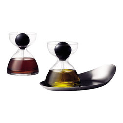 MENU - Pipette Glass with Tray, Set of 2 - These beautiful serving glasses can hold anything from oil and vinegar to maple syrup to pesto. The innovative design effortlessly dispenses your favorite flavors, and they sit neatly on a stylish little tray. It's the perfect addition to your dinner table.