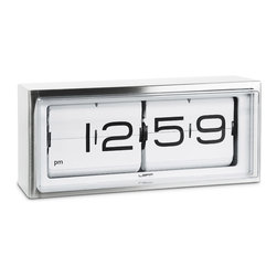 LEFF - Brick Desk / Wall Clock - The ultimate heavy duty piece of our collection. A vintage flip clock, reinvented and redesigned, with a unique combination of materials and graphics. Inside the stainless steel case a precision machine provides you a different composition of numbers every minute. This clock can be displayed on a desk or hung to the wall. Available in a 24 hour or an AM/PM version.