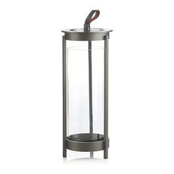 Carmel Large Lantern - Royce Nelson-designed lanterns make a spectacular show of flicker candlelight. Footed base gives candles a lift, rising in an open cylinder pewter-toned aluminum. Leather tab mixes media as a casual, practical handle.