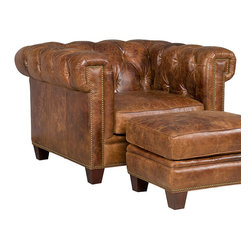Frontgate - Kensington Chair - Top-grain leather with a Malawi Tonga finish. Features Chesterfield trademarks including button tufting, set-in panel arms, a hand-hammered brass nailhead trim, and a rolled back with continuous track arms – which are slightly squared for a fresher silhouette. Dark walnut block feet. Made of kiln-dried, laminated, and select hardwoods, precision-machined for a fluid and consistent shape. High-quality 15-ply engineered frame offers dimensional stability and prevents warping. We've placed the rich, historical elegance of a Chesterfield sofa in a space-conscious chair ready to grace a study or TV room. Defined by a comfortable, tufted rolled back and continuous track arms, our Kensington Chair offers an iconic style that complements decor ranging far beyond its English origins. Luxurious top-grain leather with a distressed medium-brown finish adds to its aged ambiance. . Features Chesterfield trademarks including button tufting, set-in panel arms, a hand-hammered brass nailhead trim, and a rolled back with continuous track arms - which are slightly squared for a fresher silhouette. . . . Computer-gauged webbed seating system for consistent support. Pattern-cut urethane foam interior padded with felt polyester fibers for ultimate comfort, loft, and recovery. Highly resilient, high-density foam core seat cushion is wrapped with virgin polyester fibers and covered with a special ticking for lasting luxurious comfort and a pleasing crown appearance. The Kensington Chair, with a Malawi Tonga and dark walnut finish, ships in 14 days. Frame has a lifetime structural warranty; foam cores have a lifetime warranty not to lose their compression or crown. Coordinates with other items from our Kensington collection; ottoman sold separately.
